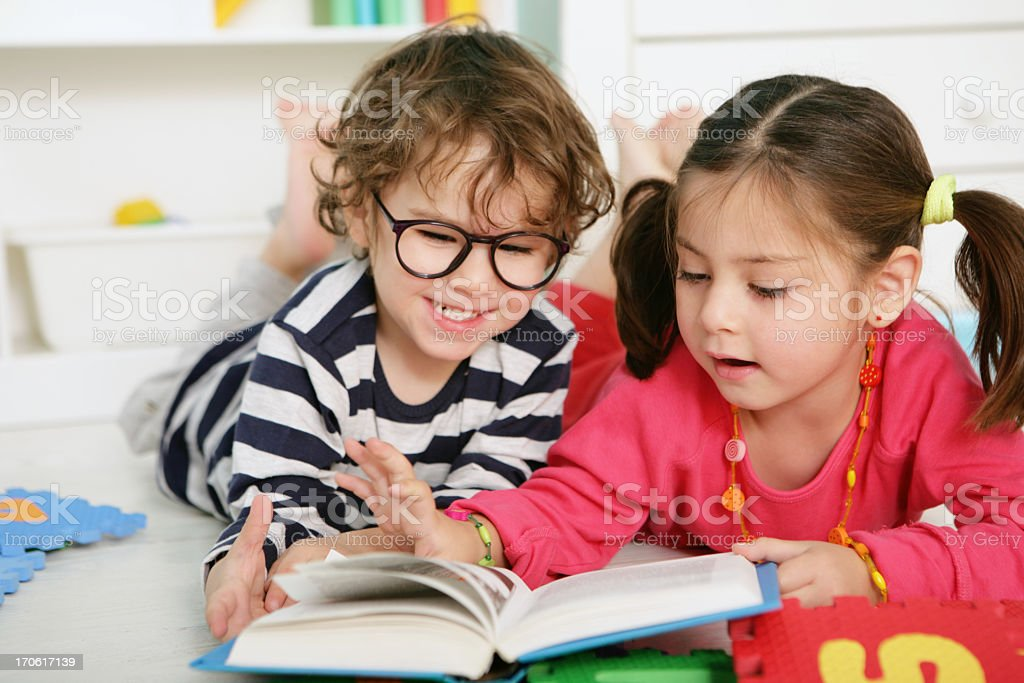 friends reading book royalty-free stock photo