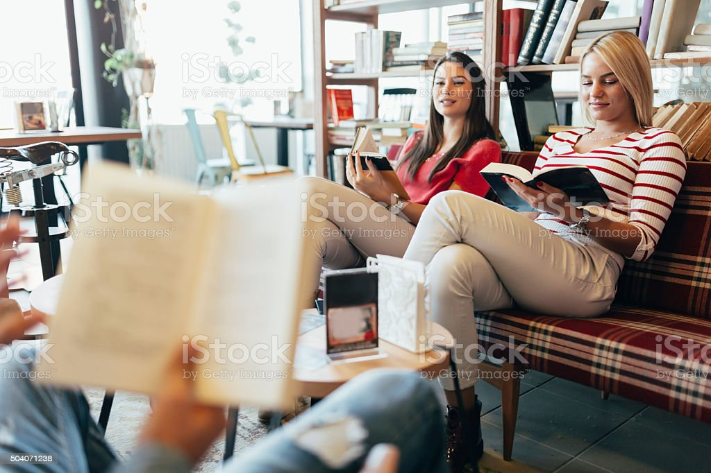 Friends reading books stock photo