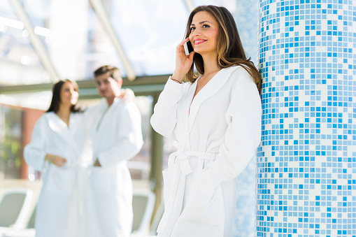 610769340 istock photo Friends relaxing in a spa next to a swimming pool 595360872