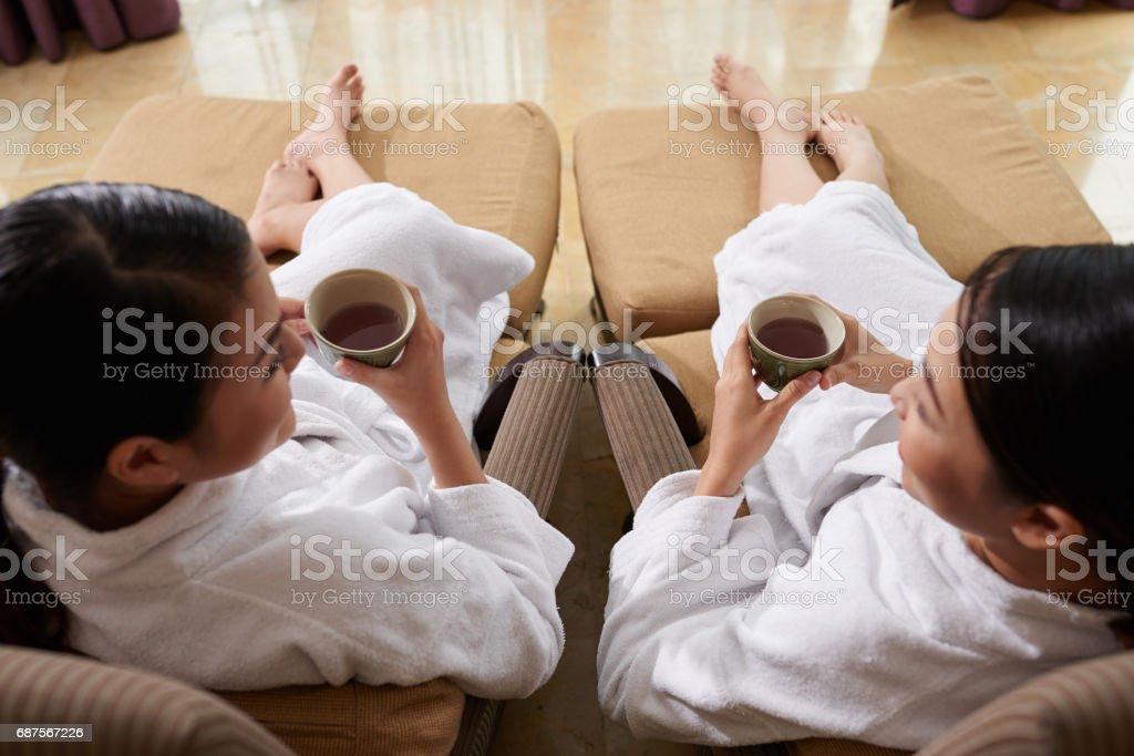 Friends Relaxing in Spa Salon stock photo