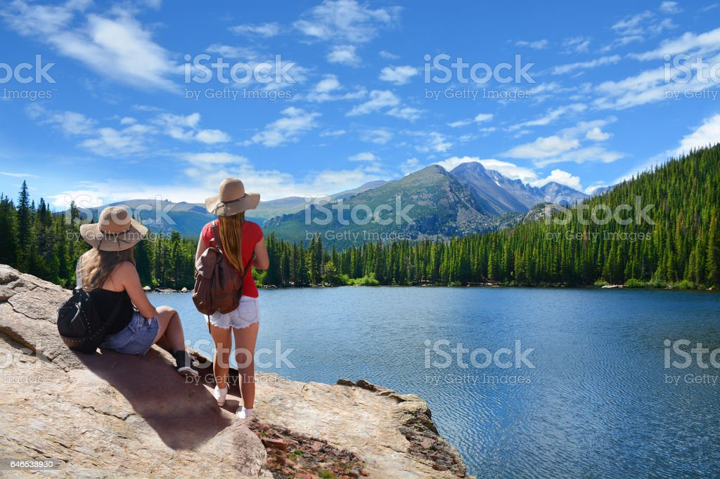 Friends relaxing on summer vacation in the mountains. stock photo