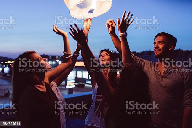 Friends releasing paper lantern in the sky at night picture id584755514?b=1&k=6&m=584755514&s=612x612&h=lx29vafa1rzg0k8ir8w9kuehoaqbxoqn7wumhw0wkrs=