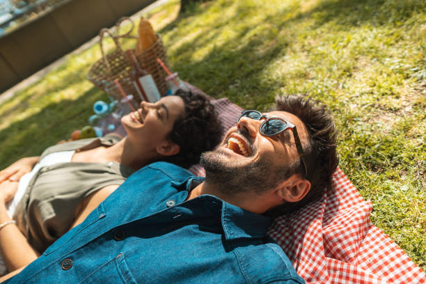 Friends resting on the picnic time Resting, Relaxation, Picnic, Tranquility, Vacation picnic stock pictures, royalty-free photos & images