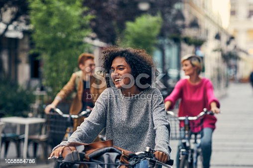 istock Friends Riding Bicycles In A City 1058884786