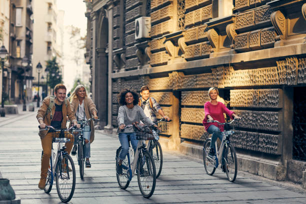Friends Riding Bicycles In A City stock photo