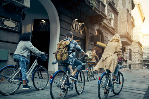 Friends Riding Rented Bicycles In A City stock photo