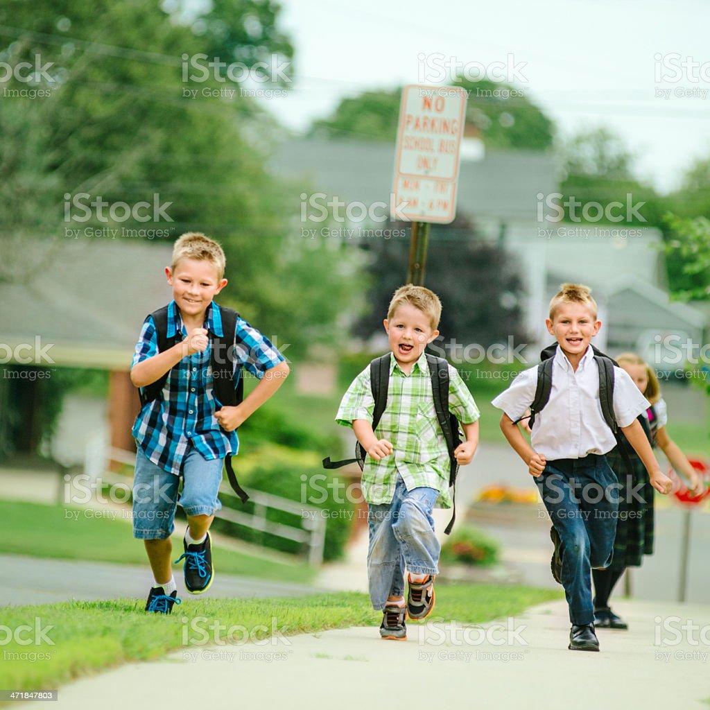 Friends running to school stock photo