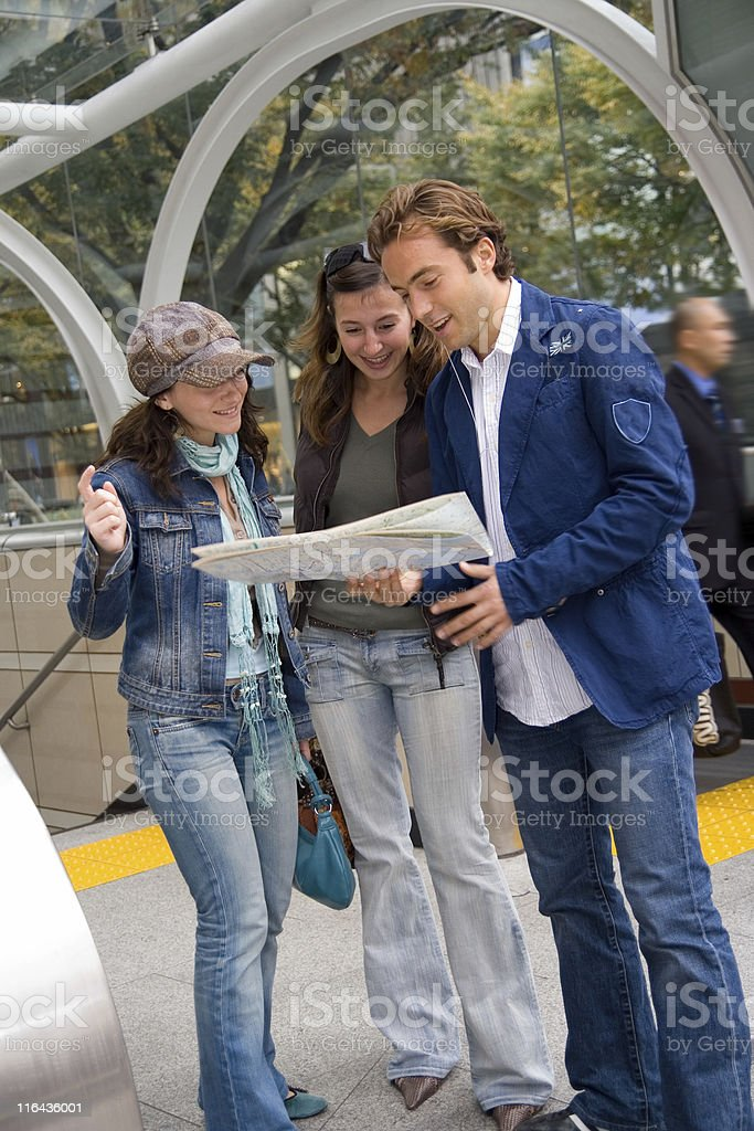 Friends searching for directions royalty-free stock photo