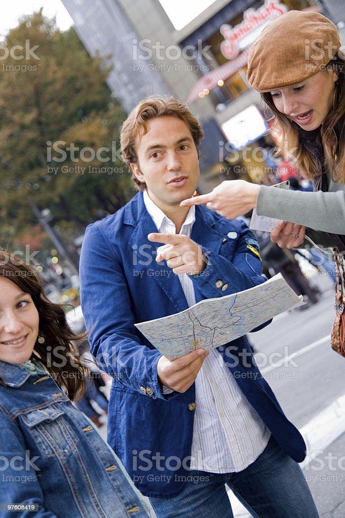 Friends searching for directions royaltyfri bildbanksbilder