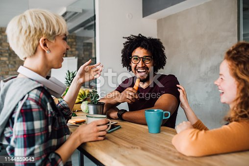 istock Friends sharing a laugh 1144859643