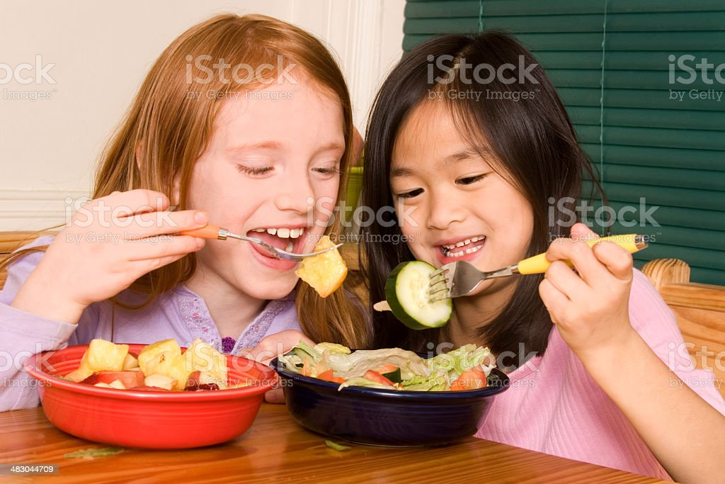 Friends sharing healthy salads royalty-free stock photo