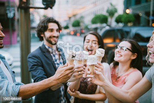 A group of young adult friends smile as they