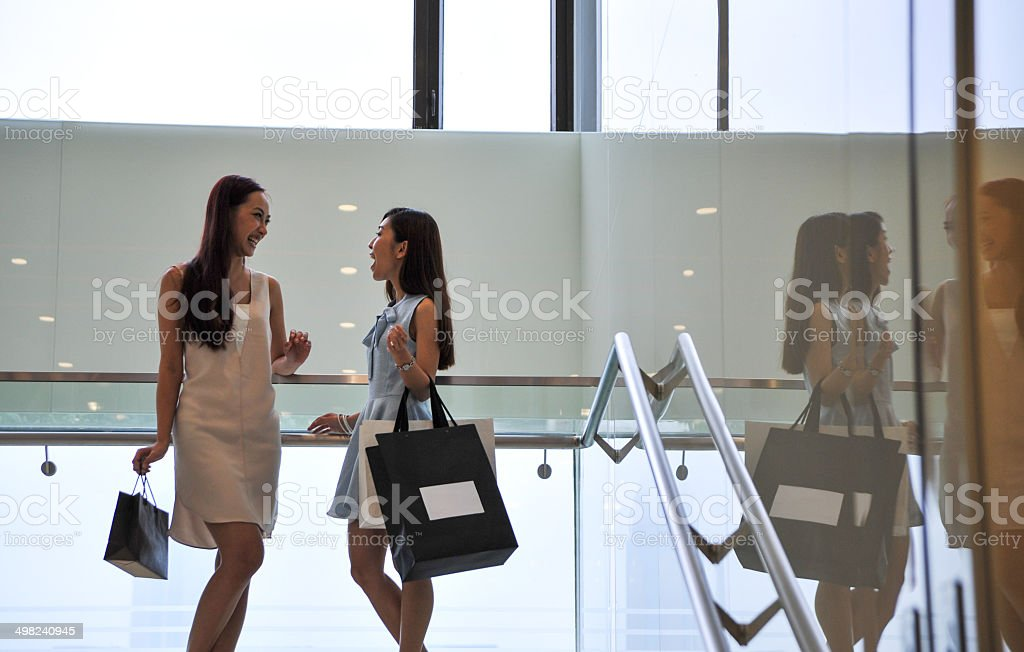 Friends shopping at a mall stock photo