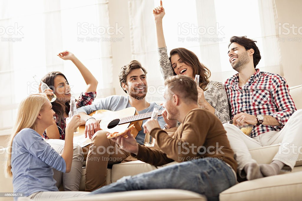 Friends singing together stock photo