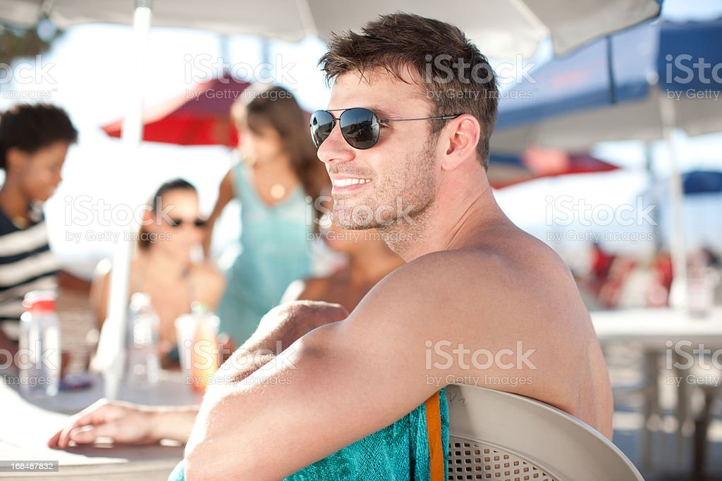 Friends sitting at table outdoors royalty-free stock photo