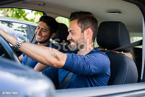 istock Friends sitting in the car ready to start vacations 679527902