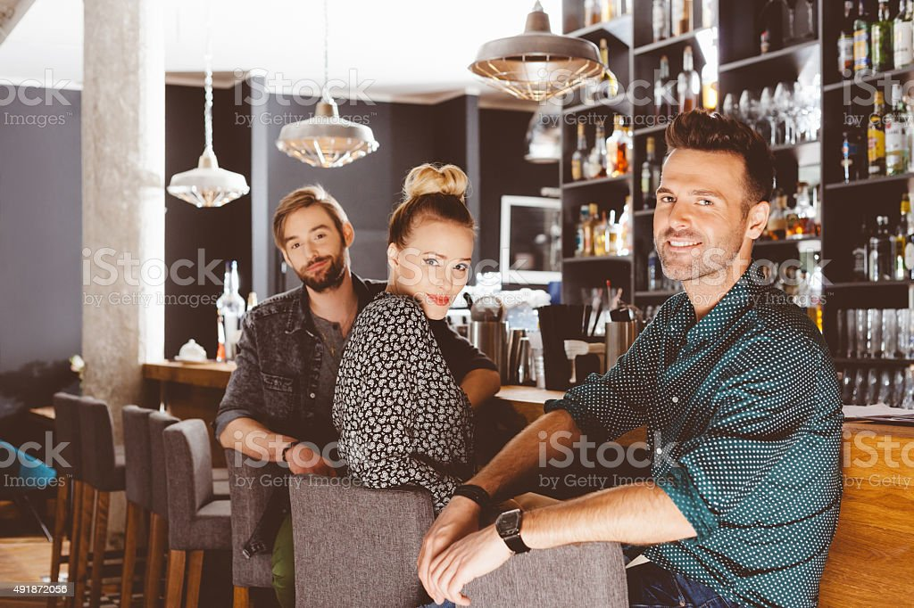 Friends sitting in the pub stock photo