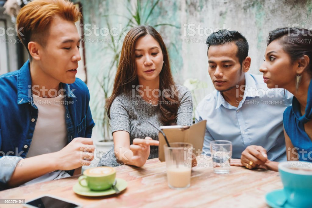 Friends sitting together in cafe kuala lumpur stock photo