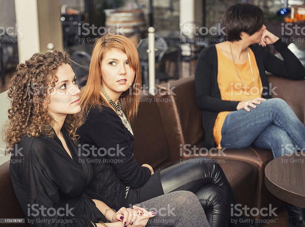 Friends sitting togetherness on the sofà at disco royalty-free stock photo