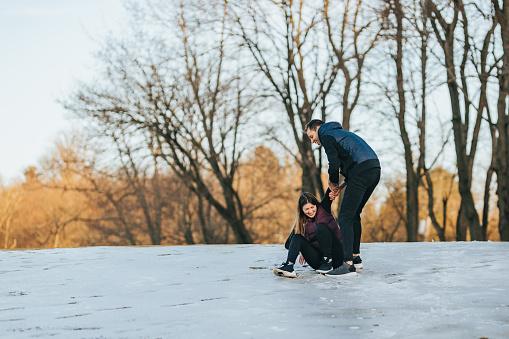 Friends slipping on snow ice