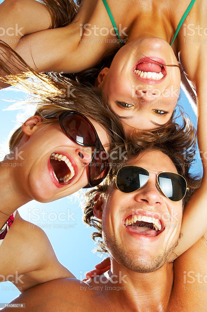 Friends smiling with joining their heads royalty-free stock photo