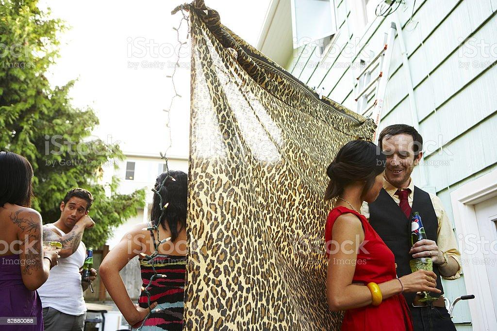 Friends socializing at backyard party royalty free stockfoto