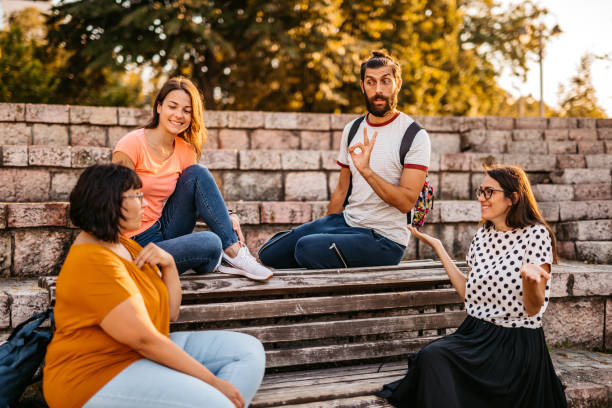 Friends speak in sign language stock photo