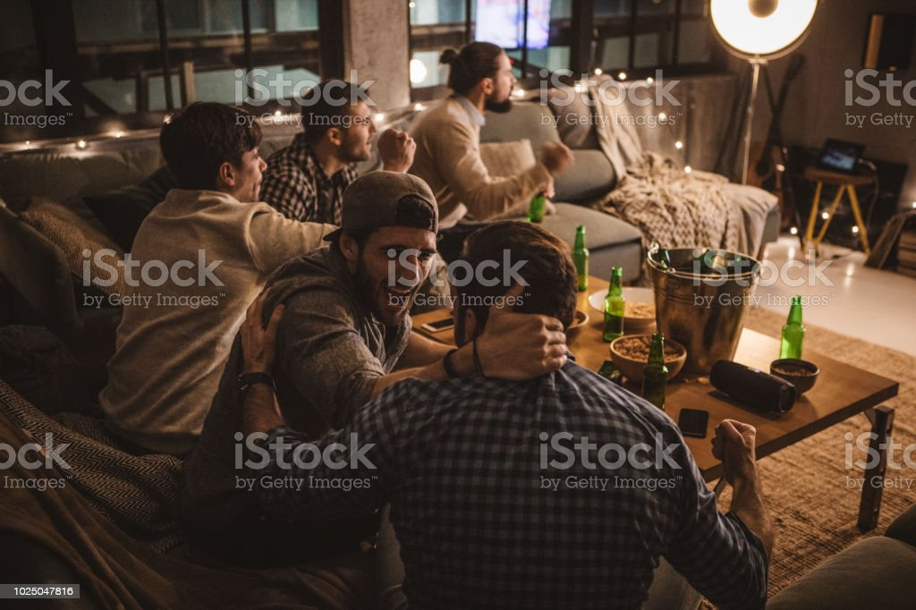 Friends spend weekend together watching TV stock photo