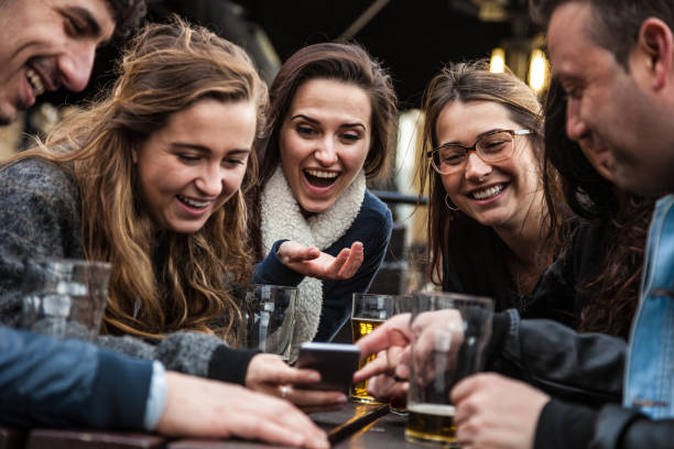 Friends spending great time together in a pub stock photo
