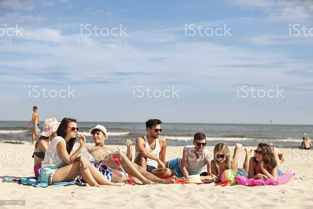 Friends Spending Time On Beach royalty-free stock photo
