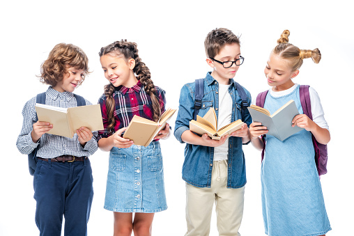 1016623732 istock photo friends standing and reading books isolated on white 1016623398