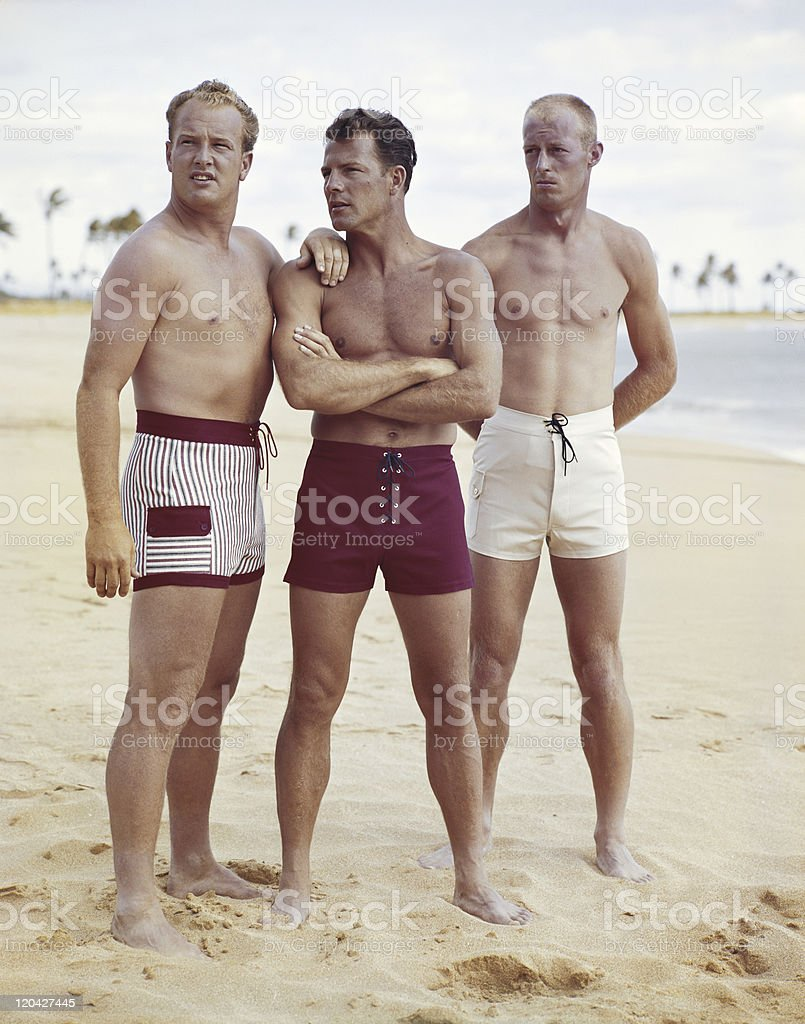 Friends standing on beach stock photo