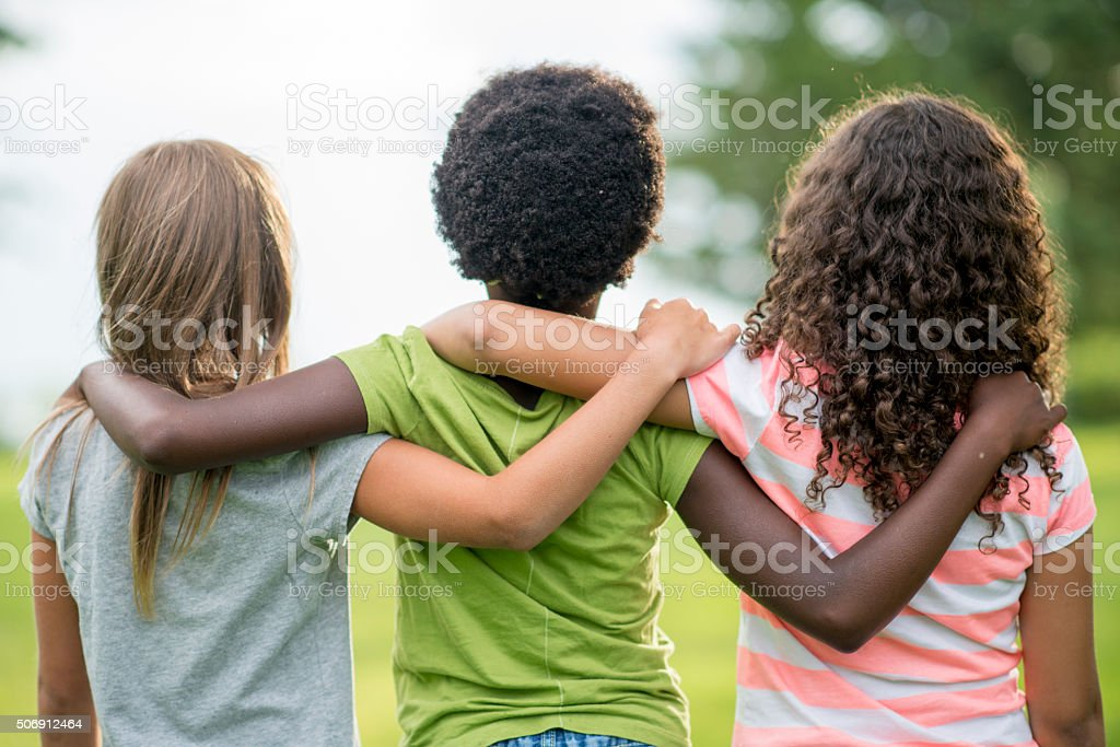Friends Standing Together stock photo