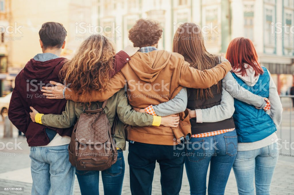 Friends standing turned back stock photo