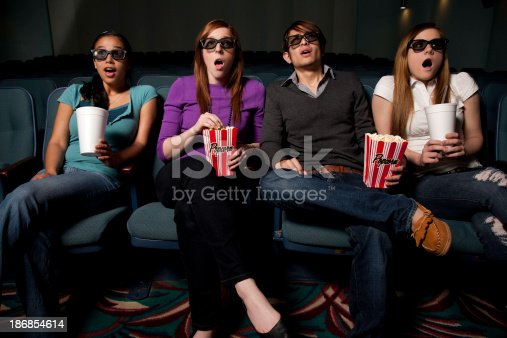 istock Friends Surprised While Watching a Movie 186854614
