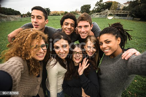 istock friends take a selfie at the park 904182856