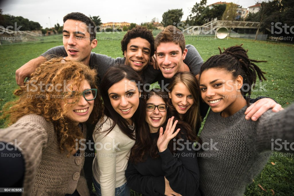 friends take a selfie at the park stock photo