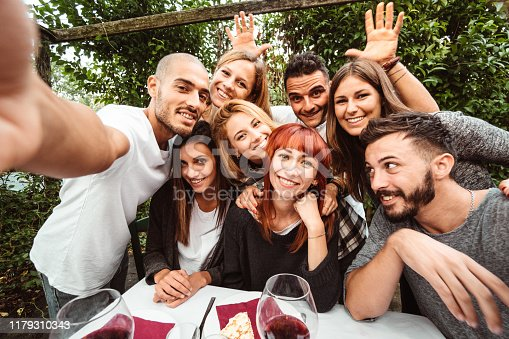 friends take a selfie at the restaurant