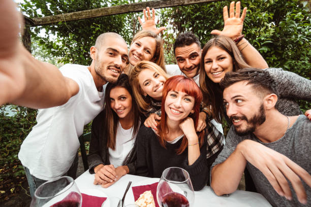 friends take a selfie at the restaurant stock photo