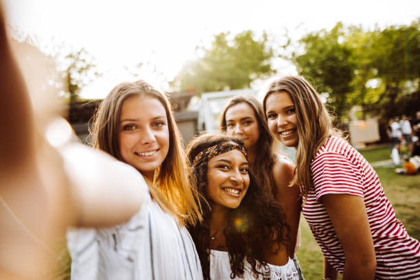 friends take a selfie in the park - concert selfie stock photos and pictures