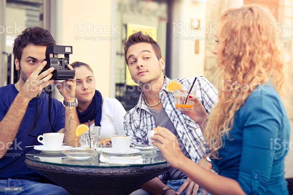 Friends take pictures stock photo
