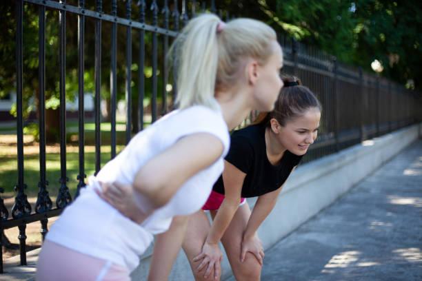 Friends taking a break from jogging stock photo
