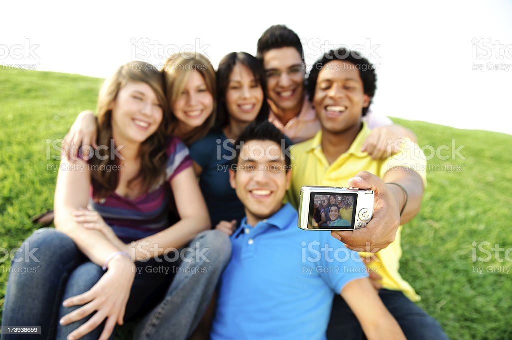 Friends taking a group picture royalty-free stock photo