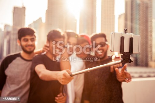 469416394 istock photo Friends taking a selfie in Dubai Marina during a vacation 468899514