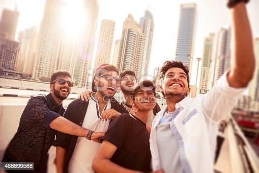 469416394 istock photo Friends taking a selfie in Dubai Marina during a vacation 468899588