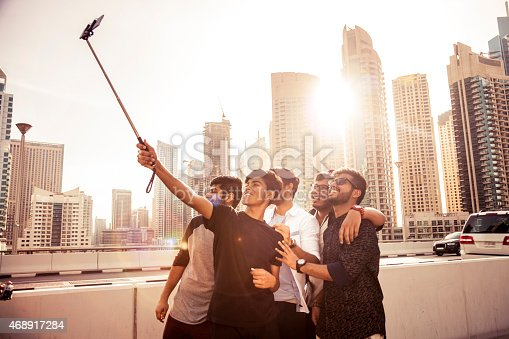 469416394 istock photo Friends taking a selfie in Dubai Marina during a vacation 468917284