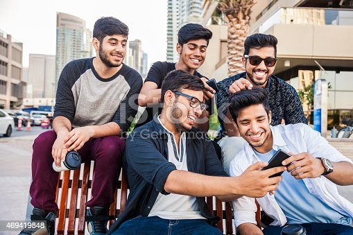 469416394 istock photo Friends taking a selfie in Dubai Marina during a vacation 469419848