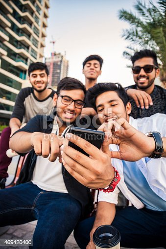 469416394 istock photo Friends taking a selfie in Dubai Marina during a vacation 469420400