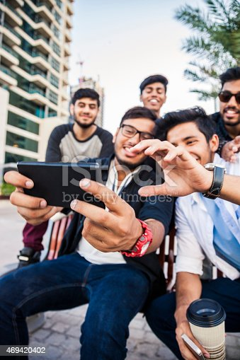 469416394 istock photo Friends taking a selfie in Dubai Marina during a vacation 469420402