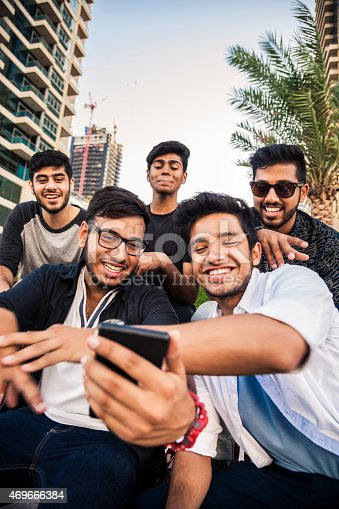 istock Friends taking a selfie in Dubai Marina during a vacation 469666384